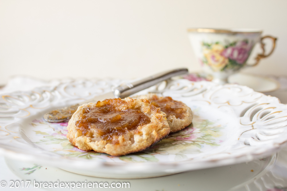 Sourdough English Muffins toasted and spread with apple butter